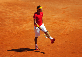 CORDOBA, SPAIN - SEPTEMBER 16:  Rafael Nadal of Spain reacts in his match against Richard Gasquet of France during day one of the semi final Davis Cup match between Spain and France at the Plaza de Toros de los Califas on September 16, 2011 in Cordoba, Sp