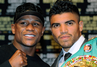 LAS VEGAS, NV - SEPTEMBER 14:  Boxers Floyd Mayweather Jr. (L) and Victor Ortiz pose during the final news conference for their bout at the MGM Grand Hotel/Casino September 14, 2011 in Las Vegas, Nevada. Mayweather will challenge Ortiz for the WBC welterw