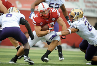 LINCOLN, NE - SEPTEMBER 17: Rex Burkhead #22 of the Nebraska Cornhuskers splits Justin Glenn #20 and Desmond Trufant #6 of the Washington Huskies during their game at Memorial Stadium September 17, 2011 in Lincoln, Nebraska.  (Photo by Eric Francis/Getty
