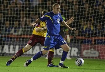 KINGSTON, ENGLAND - SEPTEMBER 13:  Lee Minshall of AFC Wimbledon looks to play the ball during the npower League Two match between AFC Wimbledon and Northampton Town at The Cherry Red Records Fans Stadium Kingsmeadow on September 13, 2011 in Kingston, Eng
