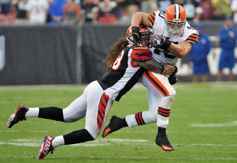CLEVELAND, OH - SEPTEMBER 11: Linebacker Rey Maualuga #58 of the Cincinnati Bengals tackles Peyton Hillis #40 of the Cleveland Browns during the fourth quarter at Cleveland Browns Stadium during a season opener  on September 11, 2011 in Cleveland, Ohio. T