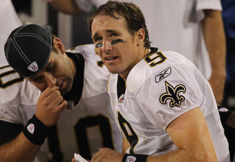 GREEN BAY, WI - SEPTEMBER 08:  Drew Brees #9 of the New Orleans Saints sits on the bench with Chase Daniel #10 during the NFL opening season game against the Green Bay Packers at Lambeau Field on September 8, 2011 in Green Bay, Wisconsin. The Packers defe