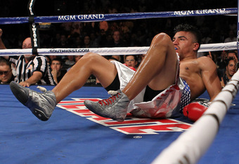 LAS VEGAS, NV - SEPTEMBER 17:  Victor Ortiz is knocked out by Floyd Mayweather Jr. in the fourth round during their WBC welterweight title fight at the MGM Grand Garden Arena on September 17, 2011 in Las Vegas, Nevada.  (Photo by Al Bello/Getty Images)