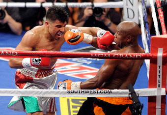 LAS VEGAS, NV - SEPTEMBER 17:  (L-R) Victor Ortiz throws a left to the face of Floyd Mayweather Jr. during their WBC welterweight title fight at the MGM Grand Garden Arena on September 17, 2011 in Las Vegas, Nevada.  (Photo by Ethan Miller/Getty Images)