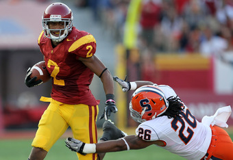 LOS ANGELES - SEPTEMBER 17:  Wide receiver Robert Woods #2 of the USC Trojans carries the ball against cornerback Kevyn Scott #26 of the Syracuse Orangemen at the Los Angeles Memorial Coliseum on September 17, 2011 in Los Angeles, California.  (Photo by S