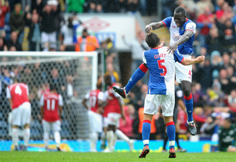 BLACKBURN, ENGLAND - SEPTEMBER 17: Chris Samba and Gael Givet of Blackburn celebrate after the fourth goal during the Barclays Premier League match between Blackburn Rovers and Arsenal at Ewood Park on September 17, 2011 in Blackburn, England.  (Photo by