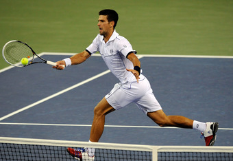NEW YORK, NY - SEPTEMBER 12:  Novak Djokovic of Serbia hits a return against Rafael Nadal of Spain during the Men's Final on Day Fifteen of the 2011 US Open at the USTA Billie Jean King National Tennis Center on September 12, 2011 in the Flushing neighbor