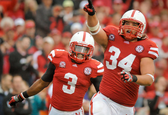 LINCOLN, NE - SEPTEMBER 17: Cameron Meredith #34 and Daimion Stafford #3 of the Nebraska Cornhuskers celebrate a 4th down stop during their game at Memorial Stadium September 17, 2011 in Lincoln, Nebraska. Nebraska won 51-38.  (Photo by Eric Francis/Getty