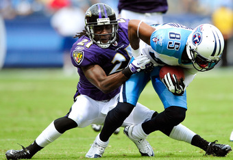 NASHVILLE, TN - SEPTEMBER 18:  Nate Washington #85 of the Tennessee Titans is tackled by Ladarius Webb #21 of the Baltimore Ravens at LP Field on September 18, 2011 in Nashville, Tennessee. Tennessee won 26-13.  (Photo by Grant Halverson/Getty Images)