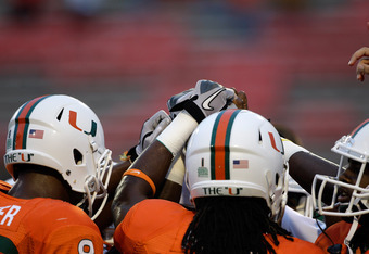 COLLEGE PARK, MD - SEPTEMBER 05: Members of the Miami Hurricanes gather before the start of their game against the Maryland Terrapins at Byrd Stadium on September 5, 2011 in College Park, Maryland.  (Photo by Rob Carr/Getty Images)