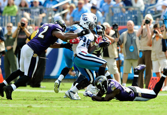 NASHVILLE, TN - SEPTEMBER 18:  Chris Johnson #28 of the Tennessee Titans is stopped for a loss by the Baltimore Ravens defense at LP Field on September 18, 2011 in Nashville, Tennessee. Tennessee won 26-13.  (Photo by Grant Halverson/Getty Images)