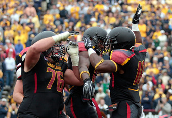 COLLEGE PARK, MD - SEPTEMBER 17: Running back D.J. Adams #10 of the Maryland Terrapins celebrates after scoring a touchdown with lineman R.J. Dill #76 during the second half against the West Virginia Mountaineers at Byrd Stadium on September 17, 2011 in C