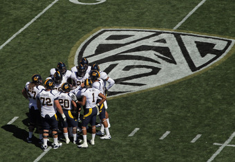 BOULDER, CO - SEPTEMBER 10:  The California Golden Bears offense huddles up as they face he Colorado Buffaloes at Folsom Field on September 10, 2011 in Boulder, Colorado.  (Photo by Doug Pensinger/Getty Images)