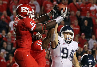 PISCATAWAY, NJ - OCTOBER 08:  Mohamed Sanu #6 of the Rutgers Scarlet Knights intercepts the ball intended for Ryan Griffin #94 of the Connecticut Huskies at Rutgers Stadium on the final play the clinch their victory on October 8, 2010 in Piscataway, New J