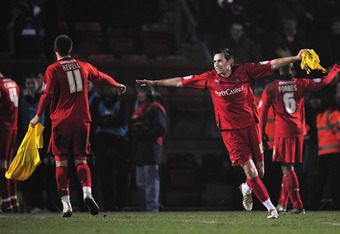Leyton Orient players celebrate their 1-1 draw against Arsenal at Matchroom Stadium on 20 Feb, 2011