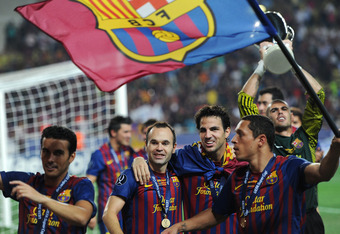 MONACO - AUGUST 26: Andres Iniesta (L) of FC Barcelona and Cesc Fabregas (R) of FC Barcelona celebrate during the UEFA Super Cup match between FC Barcelona and FC Porto at Louis II Stadium on August 26, 2011 in Monaco, Monaco.  (Photo by Jasper Juinen/Get