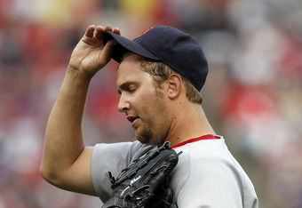 ARLINGTON, TX - APRIL 01:  Matt Albers #32 of the Boston Red Sox reacts after giving up a run against the Texas Rangers on Opening Day at Rangers Ballpark in Arlington on April 1, 2011 in Arlington, Texas.  (Photo by Tom Pennington/Getty Images)