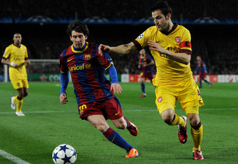 BARCELONA, SPAIN - MARCH 08:  Lionel Messi (L) of Barcelona duels for the ball with Cesc Fabregas of Arsenal during the UEFA Champions League round of 16 second leg match between Barcelona and Arsenal on March 8, 2011 in Barcelona, Spain.  (Photo by Jaspe
