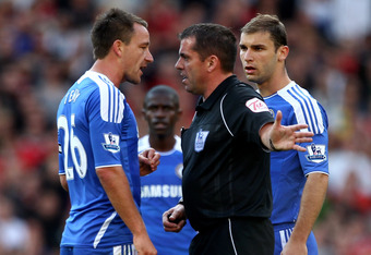 MANCHESTER, ENGLAND - SEPTEMBER 18:   John Terry of Chelsea and Referee Phil Dowd have words during the Barclays Premier League match between Manchester United and Chelsea at Old Trafford on September 18, 2011 in Manchester, England. (Photo by Clive Bruns