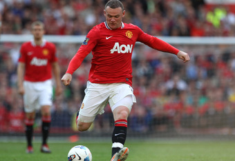 MANCHESTER, ENGLAND - SEPTEMBER 18:   Wayne Rooney of Manchester United in action during the Barclays Premier League match between Manchester United and Chelsea at Old Trafford on September 18, 2011 in Manchester, England. (Photo by Clive Brunskill/Getty