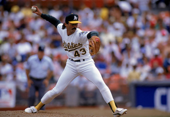 OAKLAND, CA - 1990:  Pitcher Dennis Eckersley #43 of the Oakland Athletics delivers against the Boston Red Sox during the 1990 game at the Oakland-Alameda County Coliseum in Oakland, California.  (Photo by Otto Greule Jr/Getty Images)