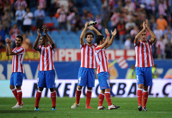 MADRID, SPAIN - SEPTEMBER 15: Atletico Madrid players applaud their supporters after they beat Celtic 2-0 in the UEFA Europa League match between Atletico Madrid and Celtic at Vicente Calderon Stadium on September 15, 2011 in Madrid, Spain.  (Photo by Den