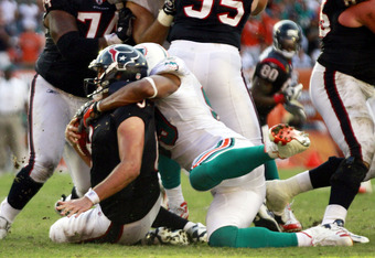 MIAMI GARDENS, FL - SEPTEMBER 18:  Quarterback Matt Schaub #8 of the Houston Texans is sacked by Defensive end Jason Taylor #99 of the Miami Dolphins at Sun Life Stadium on September 18, 2011 in Miami Gardens, Florida.  (Photo by Marc Serota/Getty Images)