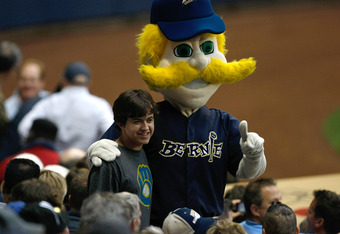 MILWAUKEE, WI - JUNE 24: Bernie Brewer poses with a fan during the game between the Minnesota Twins against the Milwaukee Brewers at Miller Park on June 24, 2011 in Milwaukee, Wisconsin. (Photo by Scott Boehm/Getty Images)