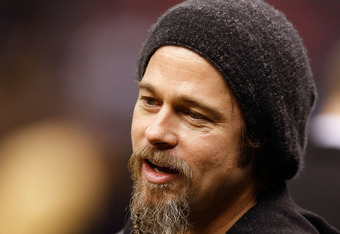 NEW ORLEANS - JANUARY 16:  Actor Brad Pitt stands on the sidelines during warm ups prior to the New Orleans Saints hosting the Arizona Cardinals during the NFC Divisional Playoff Game at Louisana Superdome on January 16, 2010 in New Orleans, Louisiana.  (