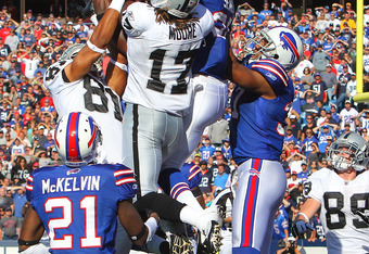 ORCHARD PARK, NY - SEPTEMBER 18: Da'Norris Searcy #25 of the Buffalo Bills catches an interception on the last play of the game during an NFL game as Denarius Moore #17 of the Oakland Raiders tres to catch the hail mary pass at Ralph Wilson Stadium on Sep