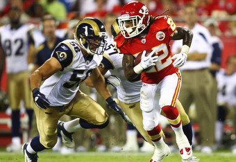KANSAS CITY, MO - AUGUST 26: Dexter McCluster #22 of the Kansas City Chiefs returns a punt against Josh Hull #56 of the St. Louis Rams during a pre-season game at Arrowhead Stadium  on August 26, 2011 in Kansas City, Missouri.  (Photo by Dilip Vishwanat/G