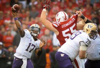 LINCOLN, NE - SEPTEMBER 17: Keith Price #17 of the Washington Huskies throws downfield over Baker Steinkuhler #55 of the Nebraska Cornhusker during their game at Memorial Stadium September 17, 2011 in Lincoln, Nebraska. Nebraska won 51-38.  (Photo by Eric