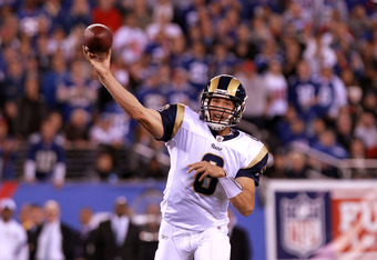 EAST RUTHERFORD, NJ - SEPTEMBER 19:  Sam Bradford #8 of the St. Louis Rams throws a pass against the New York Giants at MetLife Stadium on September 19, 2011 in East Rutherford, New Jersey.  (Photo by Nick Laham/Getty Images)