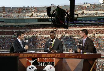 AUSTIN, TX - SEPTEMBER 10: Longhorn Network broadcasters (L - R) Lowell Galindo, Priest Holmes, and Joey Harrington report on the Texas GameDay set before the NCAA game between the Texas Longhorns and the BYU Cougars on September 10, 2011 at Darrell K. Ro