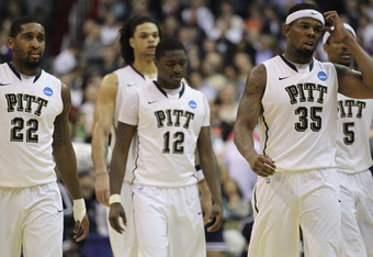 WASHINGTON - MARCH 19:  Members of the Pittsburgh basketball team including Nasir Robinson #35, Ashton Gibbs #12; and Brad Wanamaker#22 walk off the court following their loss against Butler in the third round of the 2011 NCAA men's basketball tournament