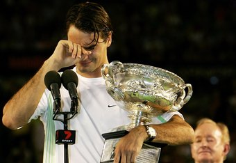 MELBOURNE, AUSTRALIA - JANUARY 29: Roger Federer of Switzerland cries as he collects the trophy after victory in his Men's Singles Final match against Marcos Baghdatis of Cyprus during day fourteen of the Australian Open at Melbourne Park January 29, 2006
