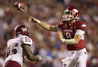 FAYETTEVILLE, AR - SEPTEMBER 17:  Tyler Wilson #8 of the Arkansas Razorbacks throws a pass against the Troy Trojans at Donald W. Reynolds Razorback Stadium on September 17, 2011 in Fayetteville, Arkansas.  The Razorbacks beat the Trojans 38 to 28.  (Photo