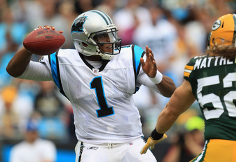 Cam Newton is a rookie...not putting up traditional rookie numbers. Where's the D?