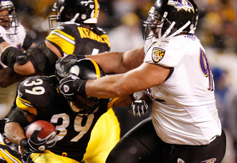 PITTSBURGH - JANUARY 18:  Nose tackel Haloti Ngata #92 of the Baltimore Ravens attempts to tackel Willie Parker #39 of the Pittsburgh Steelers during the AFC championship game on January 18, 2009 at Heinz Field in Pittsburgh, Pennsylvania.  (Photo by Greg