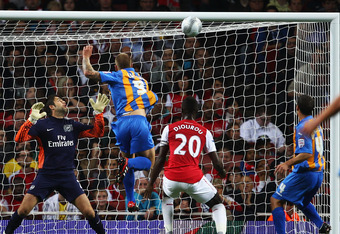 LONDON, ENGLAND - SEPTEMBER 20:  James Collins of Shrewsbury Town (9) scores their first goal with a header as golakeeper Lukasz Fabianski of Arsenal (L) looks on during the Carling Cup Third Round match between Arsenal and Shrewsbury Town at Emirates Sta