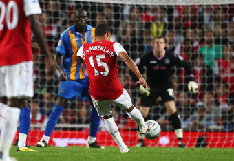 LONDON, ENGLAND - SEPTEMBER 20:  Alex Oxlade-Chamberlain of Arsenal (15) scores their second goal during the Carling Cup Third Round match between Arsenal and Shrewsbury Town at Emirates Stadium on September 20, 2011 in London, England.  (Photo by Julian