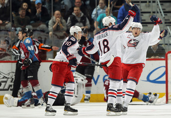 DENVER, CO - MARCH 22:  R.J. Umberger #18 of the Columbus Blue Jackets celebrates his third period goal with his teammates to give the Blue Jackets a 4-3 lead over the Colorado Avalanche at the Pepsi Center on March 22, 2011 in Denver, Colorado. The Avala