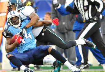 NASHVILLE, TN - DECEMBER 05:  Randy Moss #84 of the Tennessee Titans maks a catch as Don Carey #22 of the Jacksonville Jaguars defends at LP Field on December 5, 2010 in Nashville, Tennessee. The Jaguars won 17-6. (Photo by Grant Halverson/Getty Images)