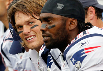FOXBORO, MA - SEPTEMBER 12: Quarterback Tom Brady #12 and Randy Moss #81 of the New England Patriots take a breather on the bench during the NFL season opener against the Cincinnati Bengals at Gillette Stadium on September 12, 2010 in Foxboro, Massachuset