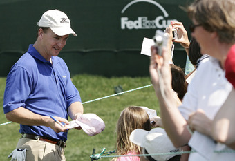 UNITED STATES - MAY 02:  Peyton Manning signs autographs during the Pro-Am prior to the 2007 Wachovia Championship held at Quail Hollow Country Club in Charlotte, North Carolina on May 2, 2007.  (Photo by Sam Greenwood/Getty Images)