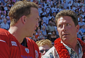 Indianapolis Colts quarterback Peyton Manning talks with Hall of Fame inductee Dan Marino before   the 2005 Pro Bowl game at Aloha Stadium, Honolulu February 13, 2005.  (Photo by Al Messerschmidt/Getty Images)