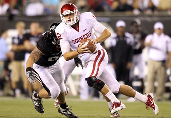 CINCINNATI - SEPTEMBER 25:  Landry Jones #12 of the Oklahoma Sooners runs with the ball during the game against the Cincinnati Bearcats at Paul Brown Stadium on September 25, 2010 in Cincinnati, Ohio.  (Photo by Andy Lyons/Getty Images)