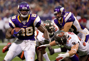 MINNEAPOLIS, MN - SEPTEMBER 18: Adrian Peterson #28 of the Minnesota Vikings avoids a tackle by Cody Grimm #35 of the Tampa Bay Buccaneers in the second quarter on September 18, 2011 at Hubert H. Humphrey Metrodome in Minneapolis, Minnesota. Peterson scor