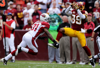 LANDOVER, MD - SEPTEMBER 18: Wide receiver Santana Moss #89 of the Washington Redskins pulls in a pass over corner back Richard Marshall #31 of the Arizona Cardinals in the first quarter at FedExField on September 18, 2011 in Landover, Maryland. (Photo by