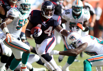 MIAMI GARDENS, FL - SEPTEMBER 18:  Running back Ben Tate #44 of the Houston Texans runs against the Miami Dolphins at Sun Life Stadium on September 18, 2011 in Miami Gardens, Florida.  (Photo by Marc Serota/Getty Images)